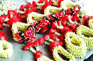 Flower garlands like these are bought/sold as protection for drivers.