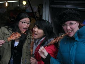 Ting, Pauline and Tanya eat squid at Nanhu market in 2008